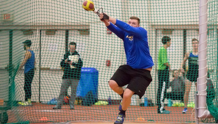 Paul Kemsley competes in the weight throw