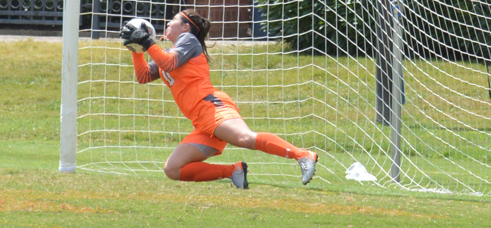Hannah Graham makes one of her seven saves in Sunday's scoreless draw with Palm Beach Atlantic (photo by Matt Bumgarner)