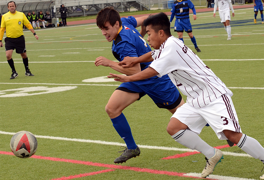 MacEwan's Michael Ho battles for a ball against a Lethbridge defender on Sunday (Courtesy Lethbridge Pronghorns).