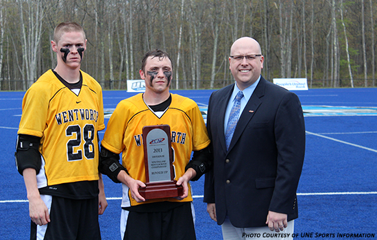 Co-captains Tyler Forthofer and Chris Kipp accept the ECAC runner-up trophy from ECAC liaison Dave Morin