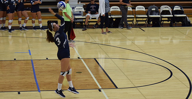 Alexis Szaro '20 serves up the ball in a match versus DeSales University.