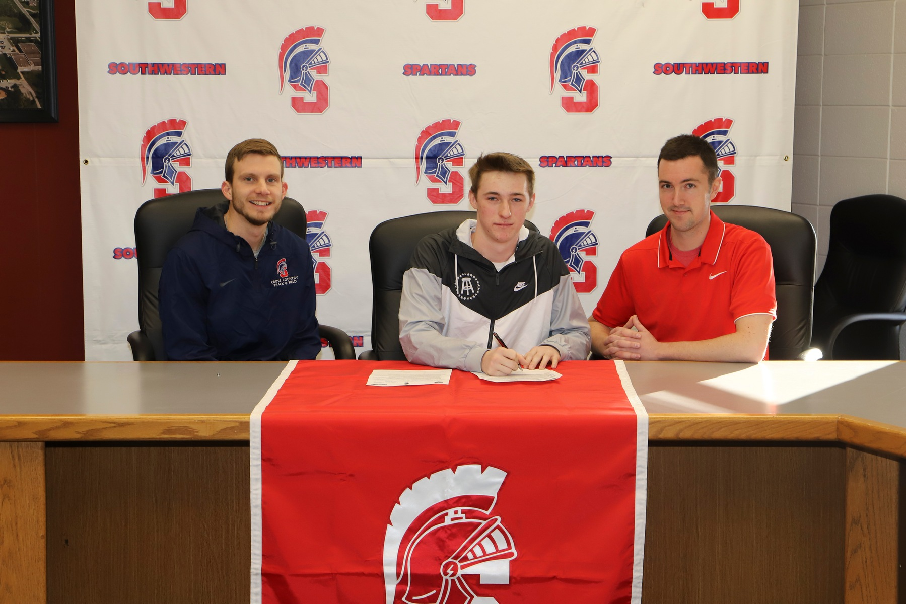 Central Decatur's Kolten Johnson signs his letter of intent with Southwestern for the 2019-20 track and field season.