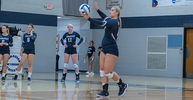 Mary Zacher 18 serves the ball versus Wilkes University in September 2017.