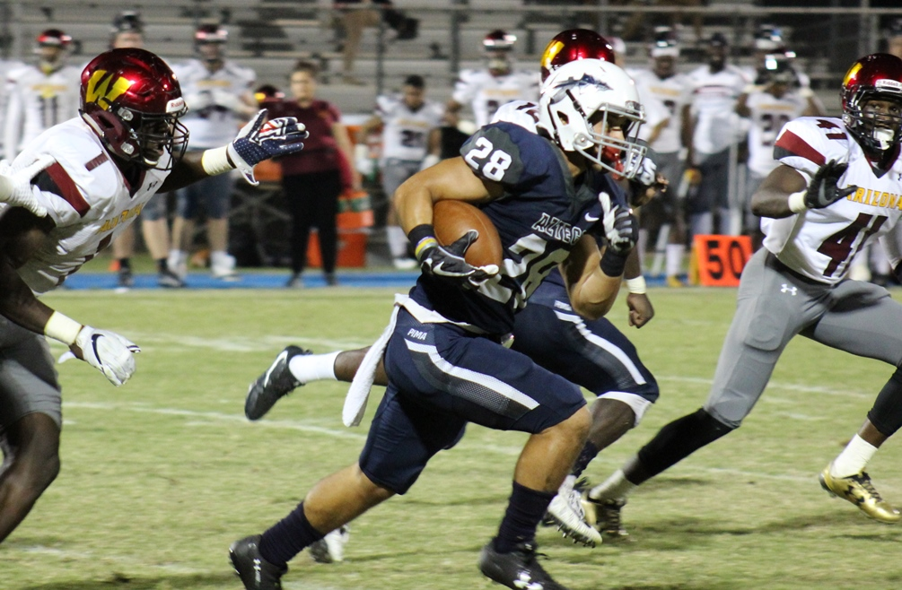 Freshman Ronson Young caught a 30-yard touchdown pass as part of Pima's rally but the Aztecs fell in double overtime to Glendale Community College 37-30. The Aztecs are now 2-8 overall and 0-6 in WSFL play. Photo by Rene Escobar