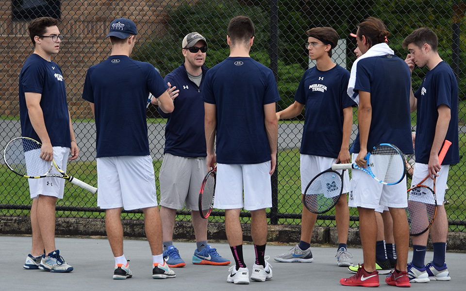 First-year Director of Tennis Aaron Wilf addresses the Greyhounds before the season-opener with Muhlenberg College at Hoffman Courts.