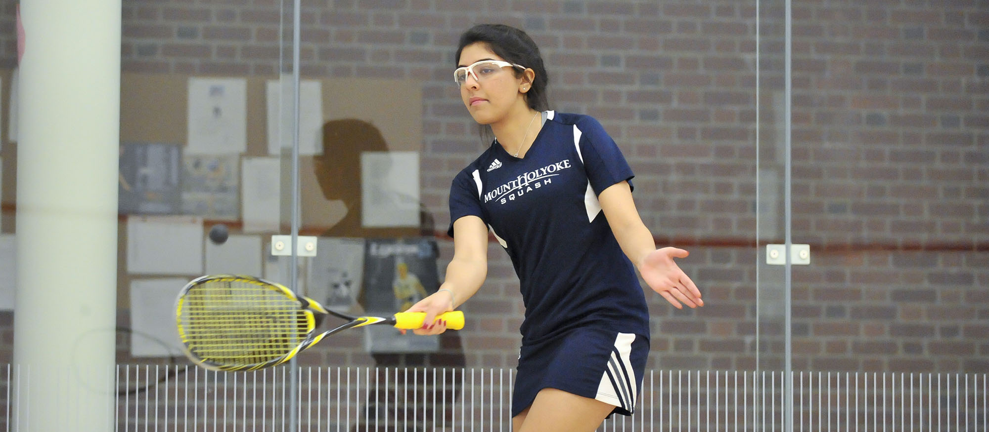 Action photo of Lyons squash player, Ragini Ghose