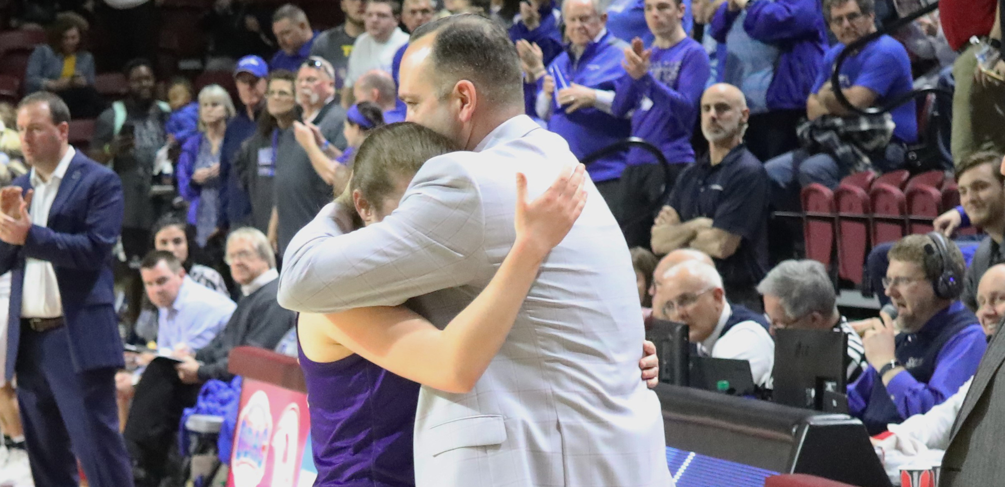 Head coach Trevor Woodruff hugs senior Bridgette Mann as Mann is taken out of the game in Scranton's 69-56 defeat to Thomas More in the 2019 NCAA Division III National Semifinals on Friday night in Salem, Va. © Photo by Timothy R. Dougherty / doubleeaglephotography.com