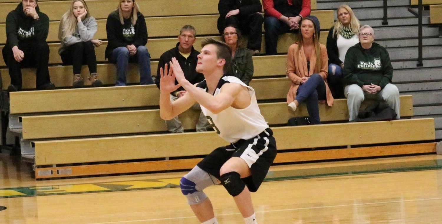 Seth Welker (8) had nine digs for the Wolves on Friday