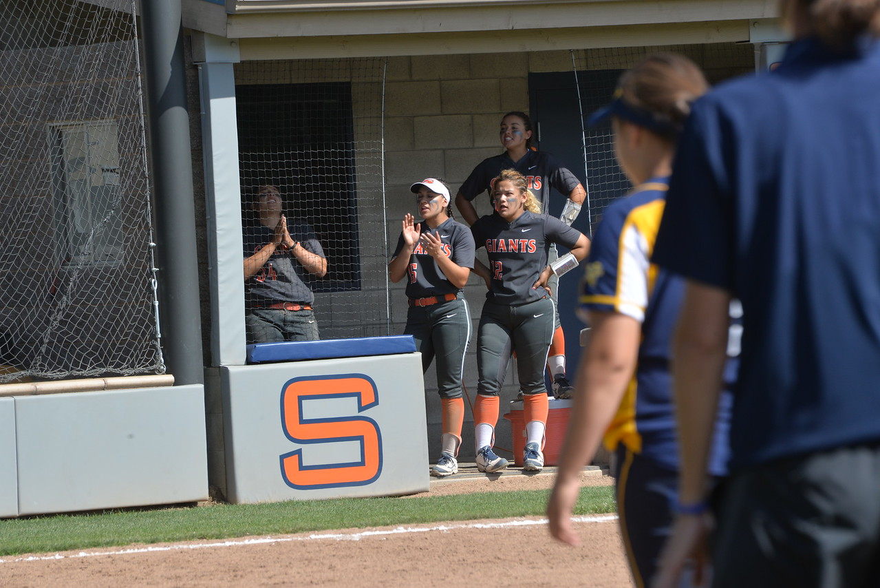 Ana Hayes and Liz Valdez cheer on their teammates during a contest earlier in the season.