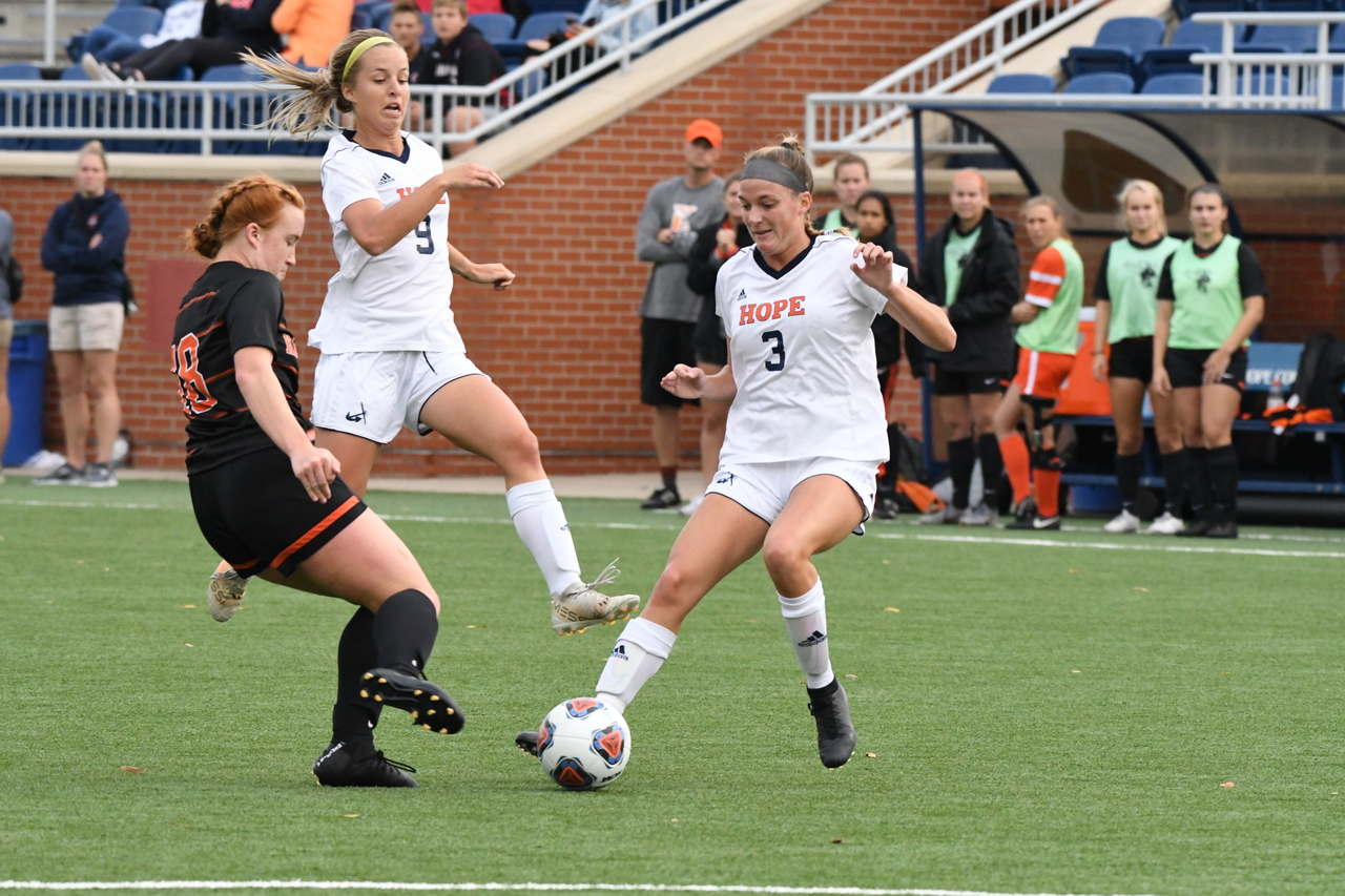 Sarah Mikesell advancing the ball with Corinne Cole