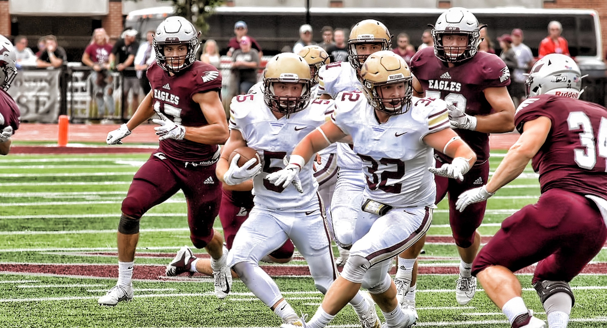 Sophomore Andy Gravdahl weaves his way through the La Crosse defense. He scored one of the two Cobber TDs on the day. (Photo courtesy of Vince Arnold)