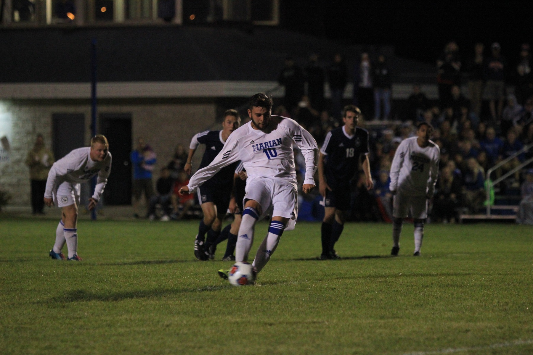 Alonso Fragoso shoots a penalty kick.