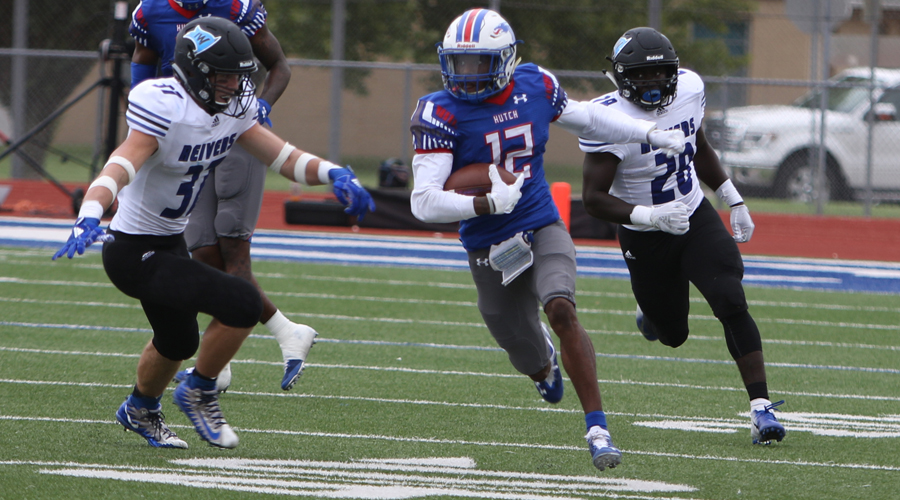 Jaylen Erwin breaks away from a pair of Iowa Western defenders on his way to a74-yard punt return for a touchdown in No. 11 Hutchinson's 33-24 loss to No. 1 IWCC on Saturday at Gowans Stadium. (Joel Powers/Blue Dragon Sports Information)