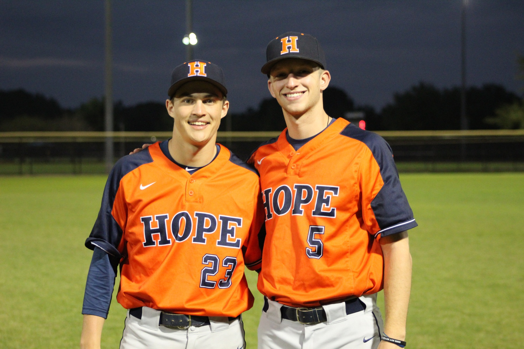Keaton Hamilton and CJ Otteman pose together for a picture at a baseball field