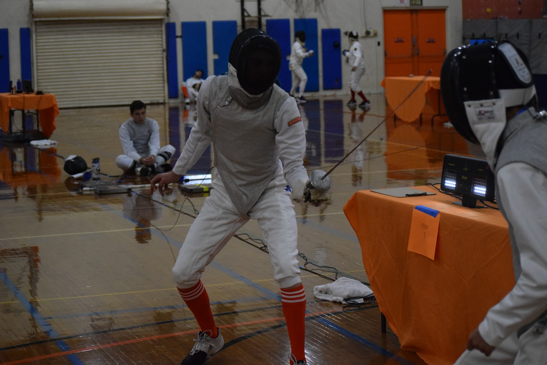 Men's Epee Bags Pair of Wins at Western Invitational