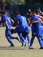 The Falcons celebrate after scoring a goal against College of the Desert