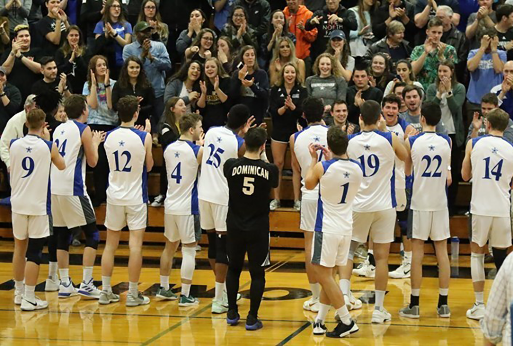 Dominican University celebrates the inaugural NACC men's volleyball tournament title.