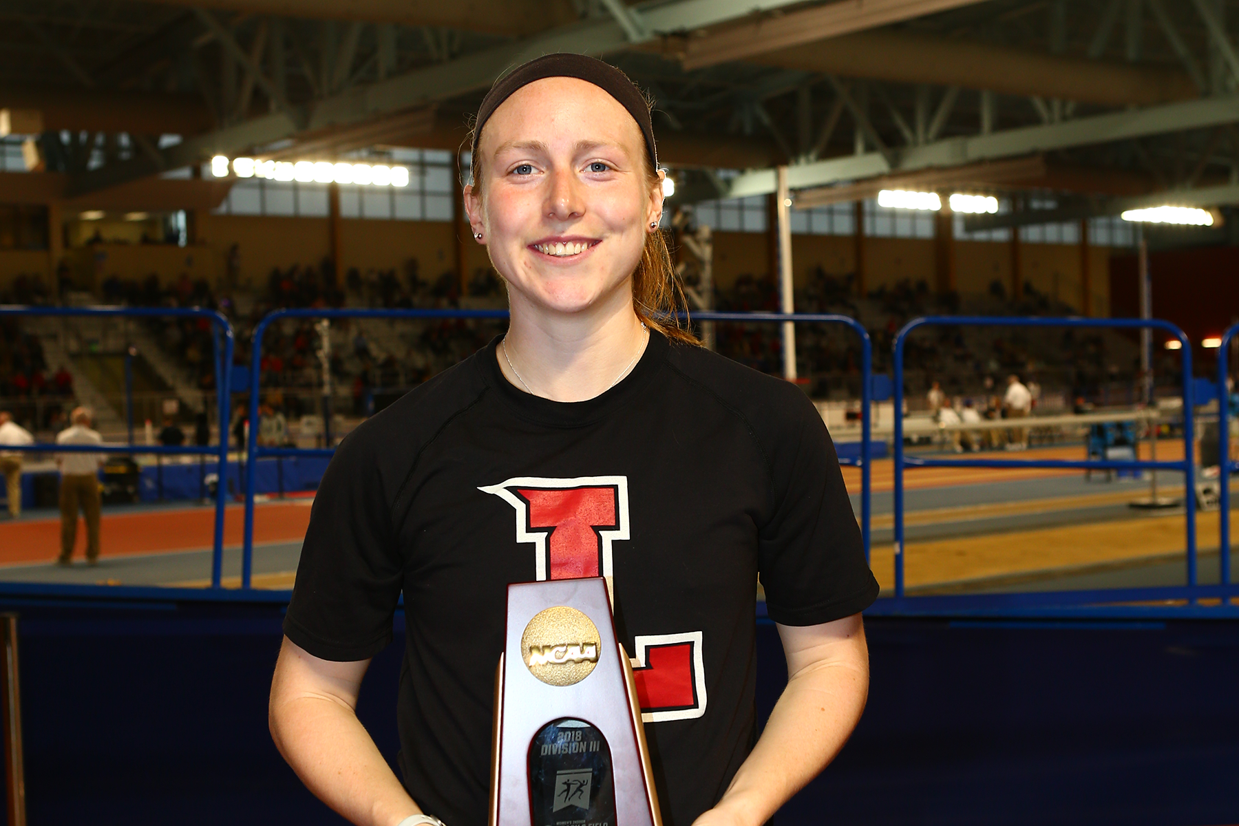 Natalie Deacon poses with her All-American award.