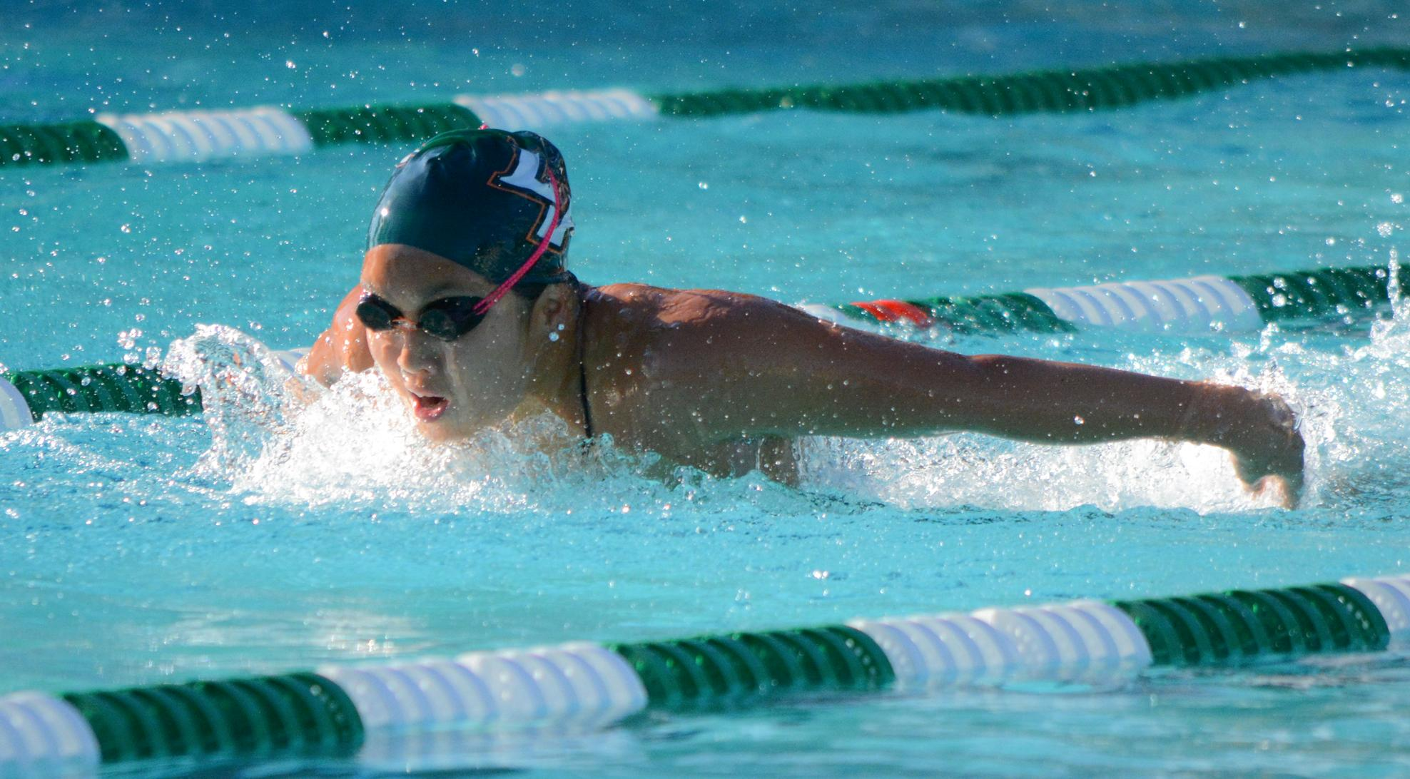 Men's Swiming & Diving beats Chapman, Women split
