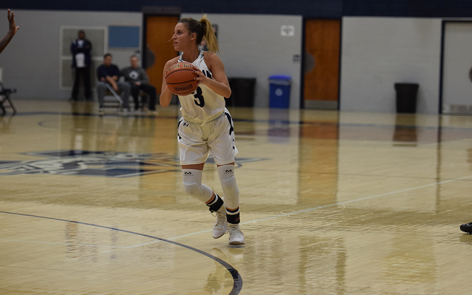 Maddie Capuano heads up court in a game versus Penn State Lehigh Valley in Johnston Hall.
