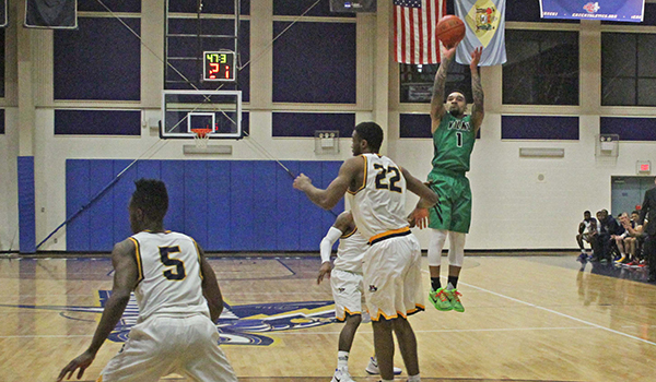Copyright 2017; Wilmington University. All rights reserved. Photo of Tyaire Ponzo-Meek's go ahead three-pointer with 47 seconds left at Goldey-Beacom, taken by Frank Stallworth.