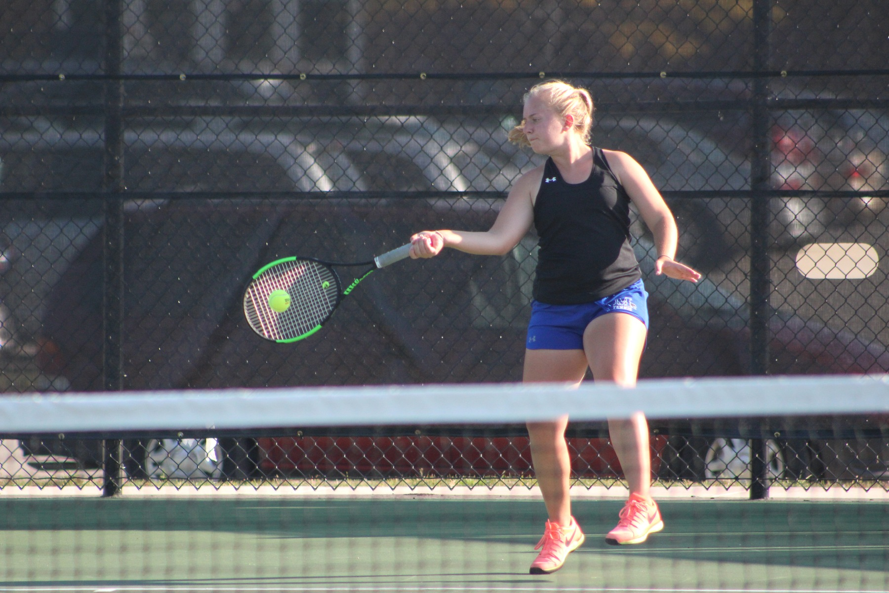 Kyrsten Bruce makes contact on her forehand.