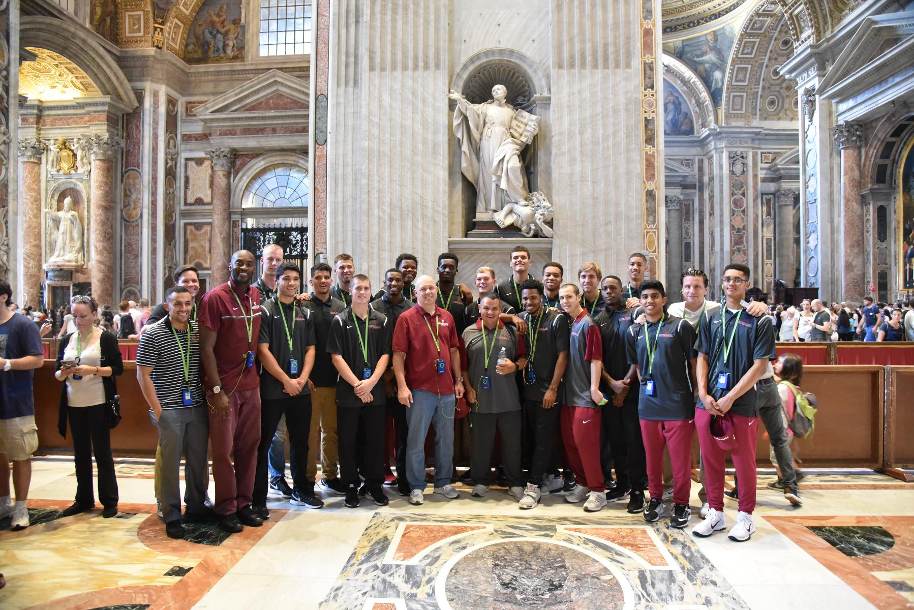 Team in front of Saint Ignatius statue (founders of the Jesuits)
