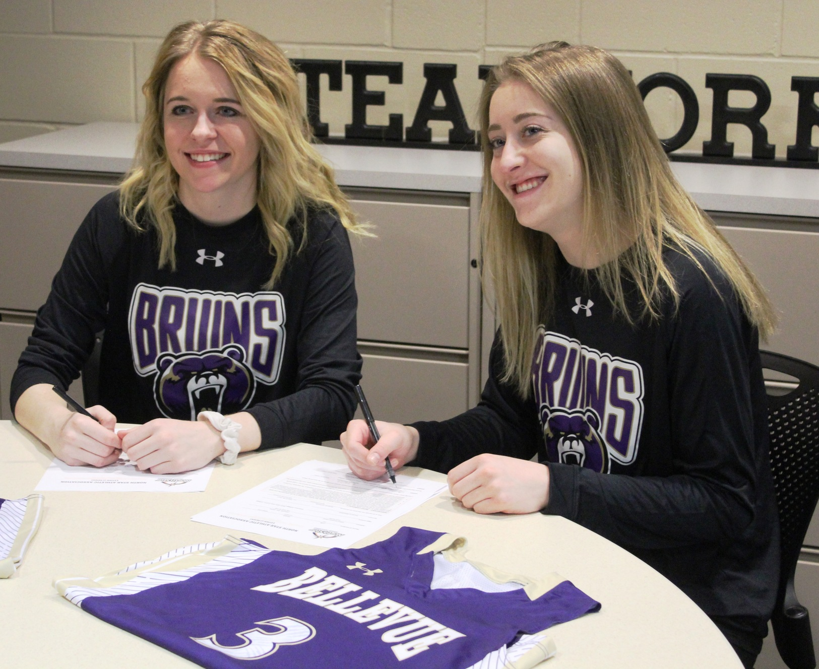 Riley Galvin (left) and Morgan Cuffe signed to play basketball next season at Bellevue University.