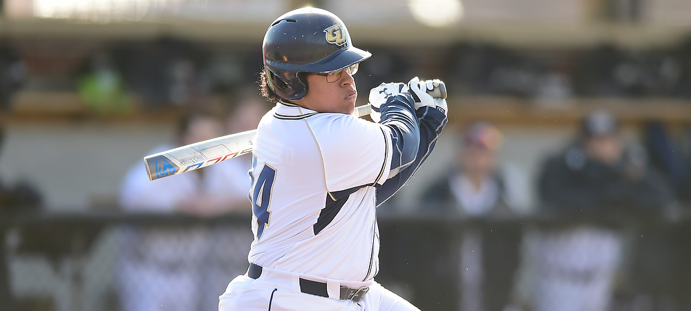 Gallaudet's Bryan Ramos-Navarro finishes his swing after attempting to hit for the Bison.