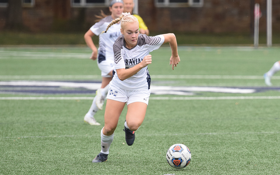 Freshman Megan Chesney moves down the field with the ball versus Alvernia University.