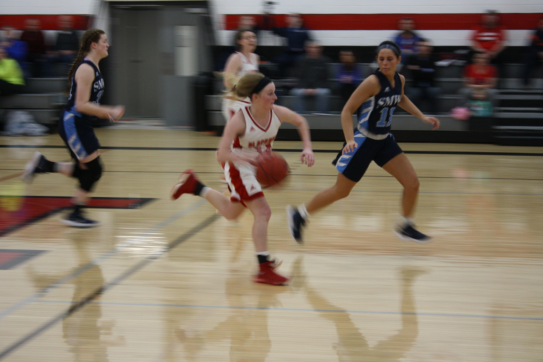 Annika Ochs (14) drives up the middle into the Beavers offensive end