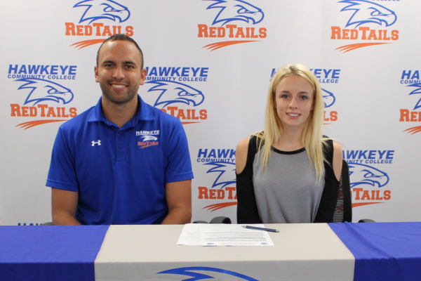 Josie Claude (R) signs her letter of intent with Head Track and Field Coach, Tyler Mulder (L)