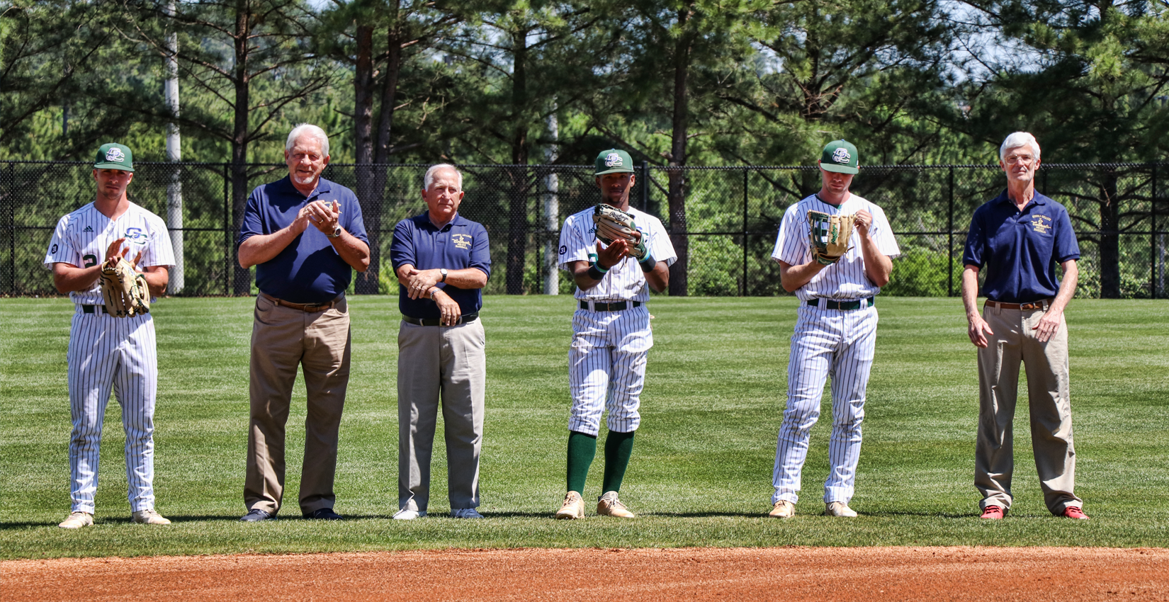 Members of the 1969 Georgia College Baseball team join the current players on the field