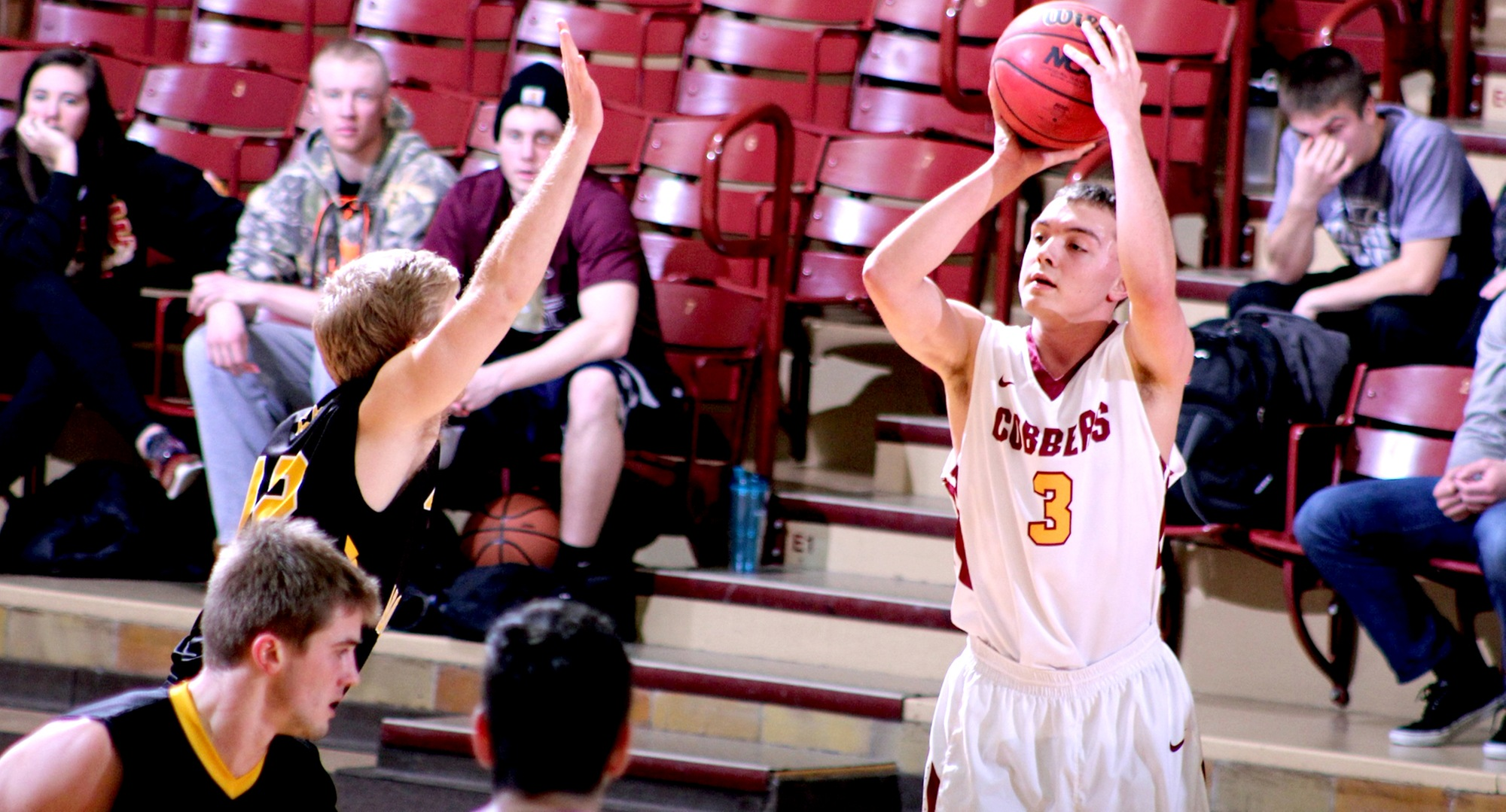 Zach Kinny gets ready to knock down one of his six 3-pointers against Gustavus. He went 8-of-12 from the floor, including 6-for-8 from beyond the arc and scored a career-high 24 points.