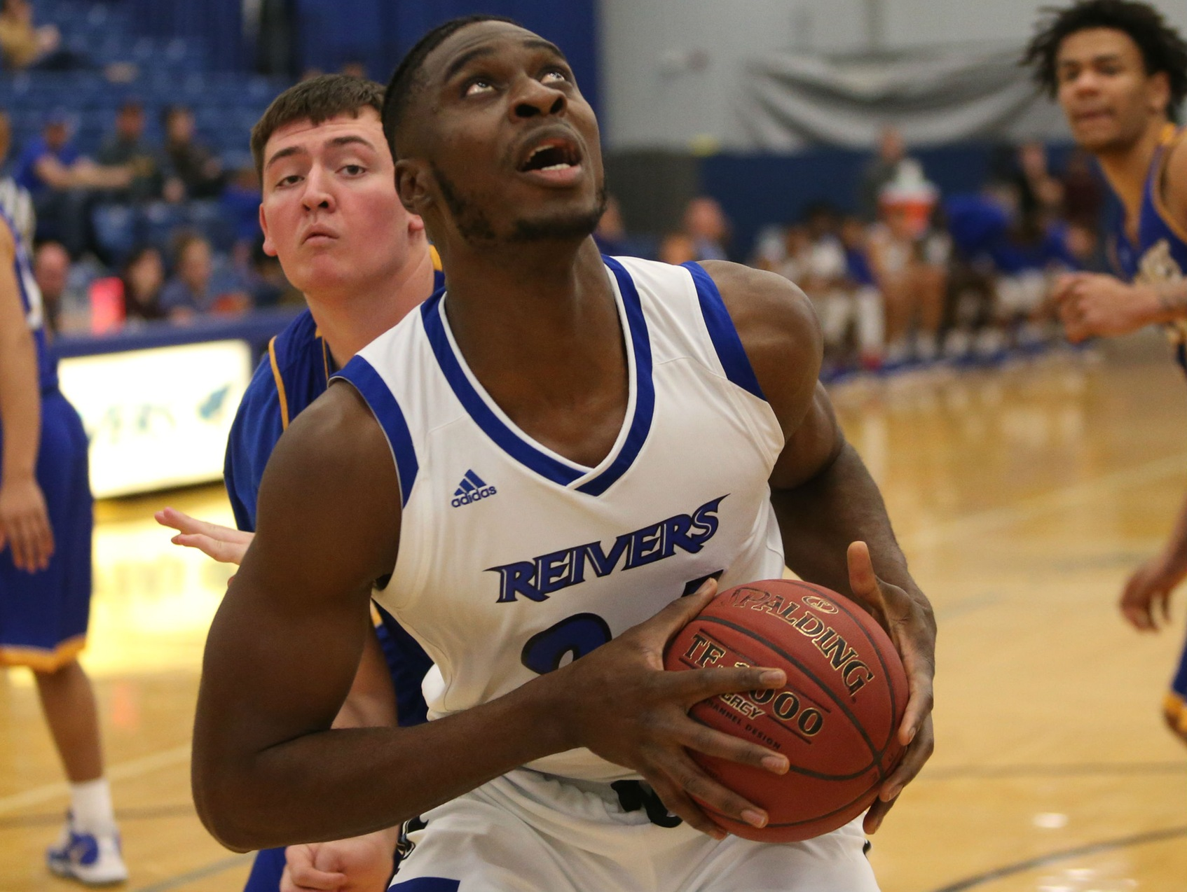 Emmanuel Ugboh was one of 13 Reivers on the men's basketball team to be honored at half-time for their Academic All-Region performances this year.