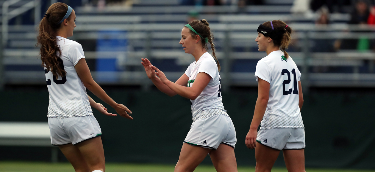 Image of Hannah Pesci celebrating a goal with her teammates Catherine Elkas and Rachel Hanna.