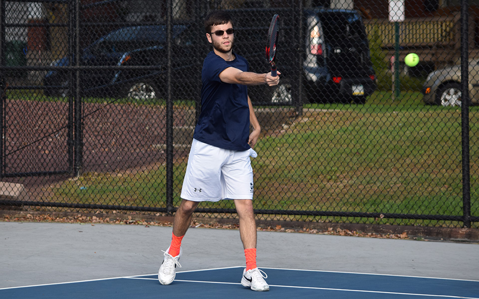 Sophomore Sean Kearns returns a shot in a match versus FDU-Florham on Hoffman Courts during the fall 2018 season.