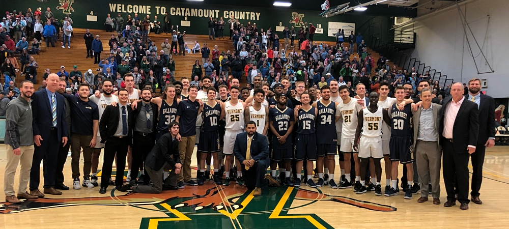 Gallaudet and Vermont teams gather for a large group photo at mid-court.