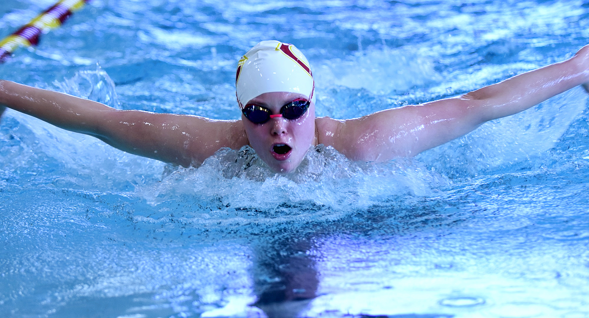 Sophomore Amy Warren swims the butterfly leg during the 200-yard individual medley during the Cobbers' dual meet with Univ. of Mary. Warren won the event in a time of 2:22.09