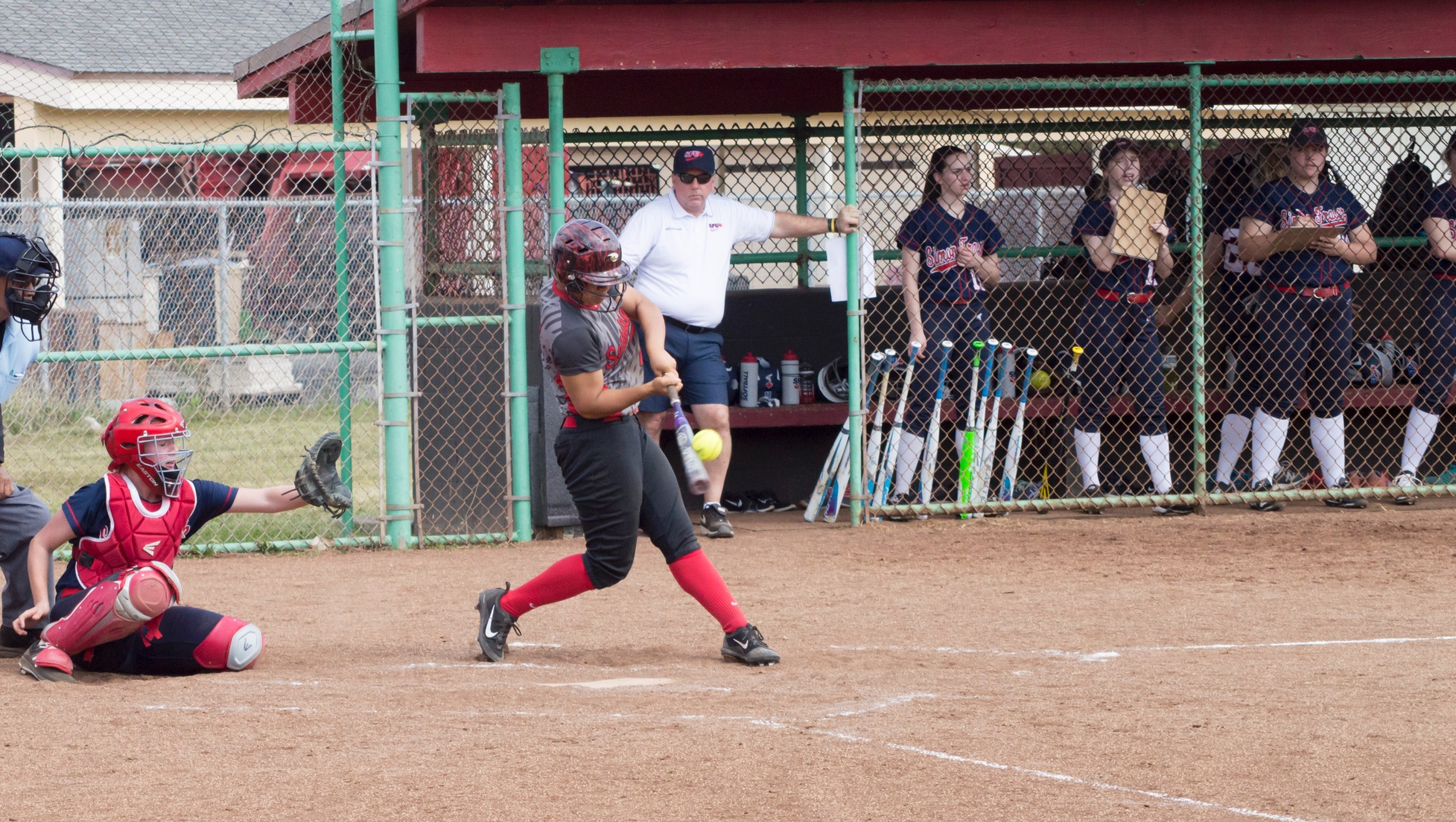 Lizabelle Talataina sends a ball over the left field wall against Simon Fraser for her second home run of the year.