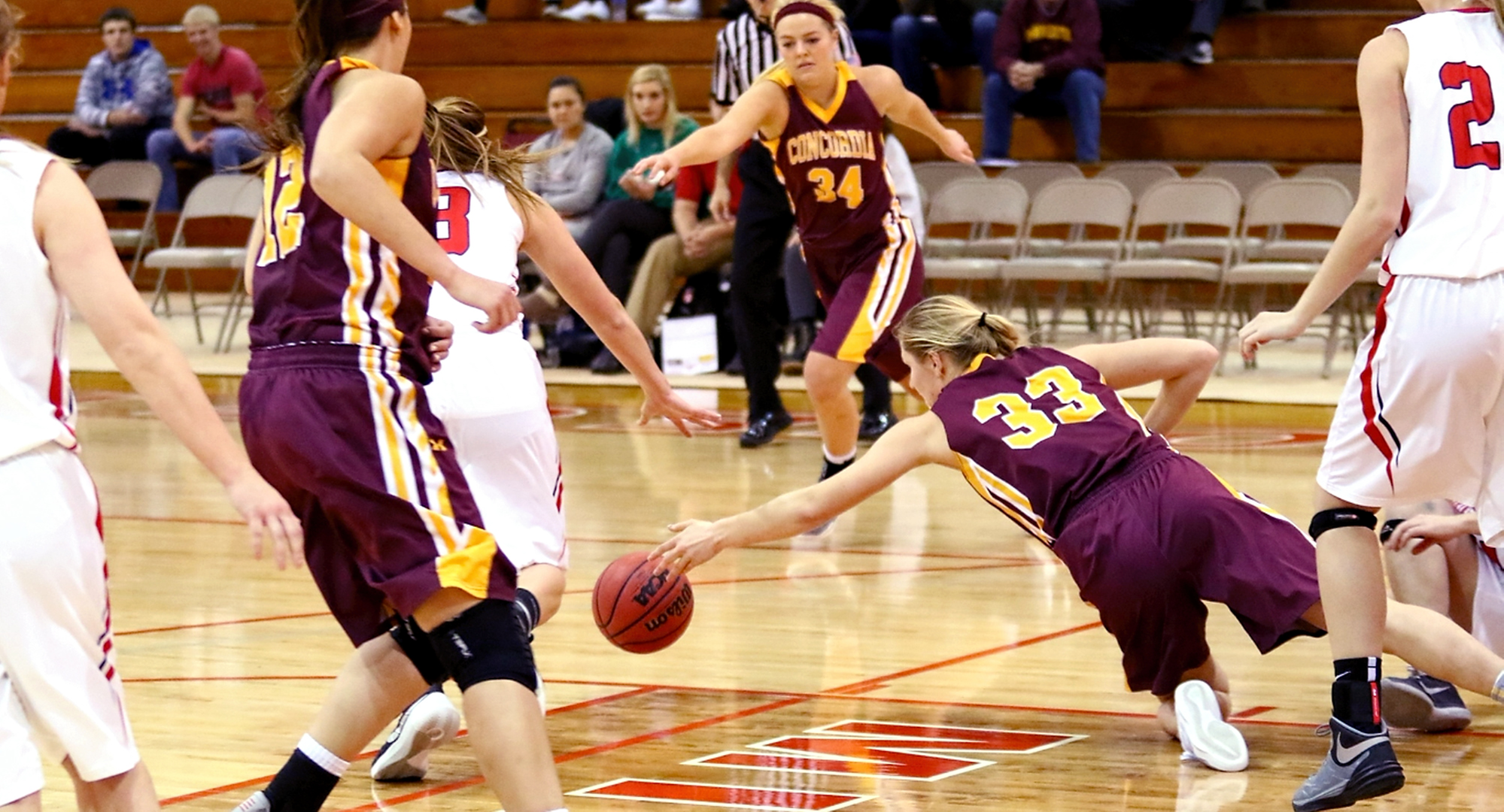 Senior Jenna Januschka dives on the floor after a loose ball in the Cobbers' game at St. Mary's. Januschka had a season-high 18 points for CC. (Photo courtesy of Ryan Coleman, D3photography.com)