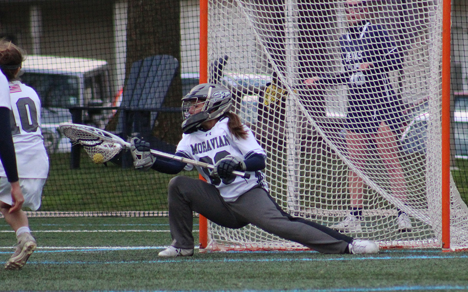 Sophomore goalie Courtney Heist makes a save on an eight-meter shot with less than a minute remaining to preserve a one-goal victory over FDU-Florham on John Makuvek Field.