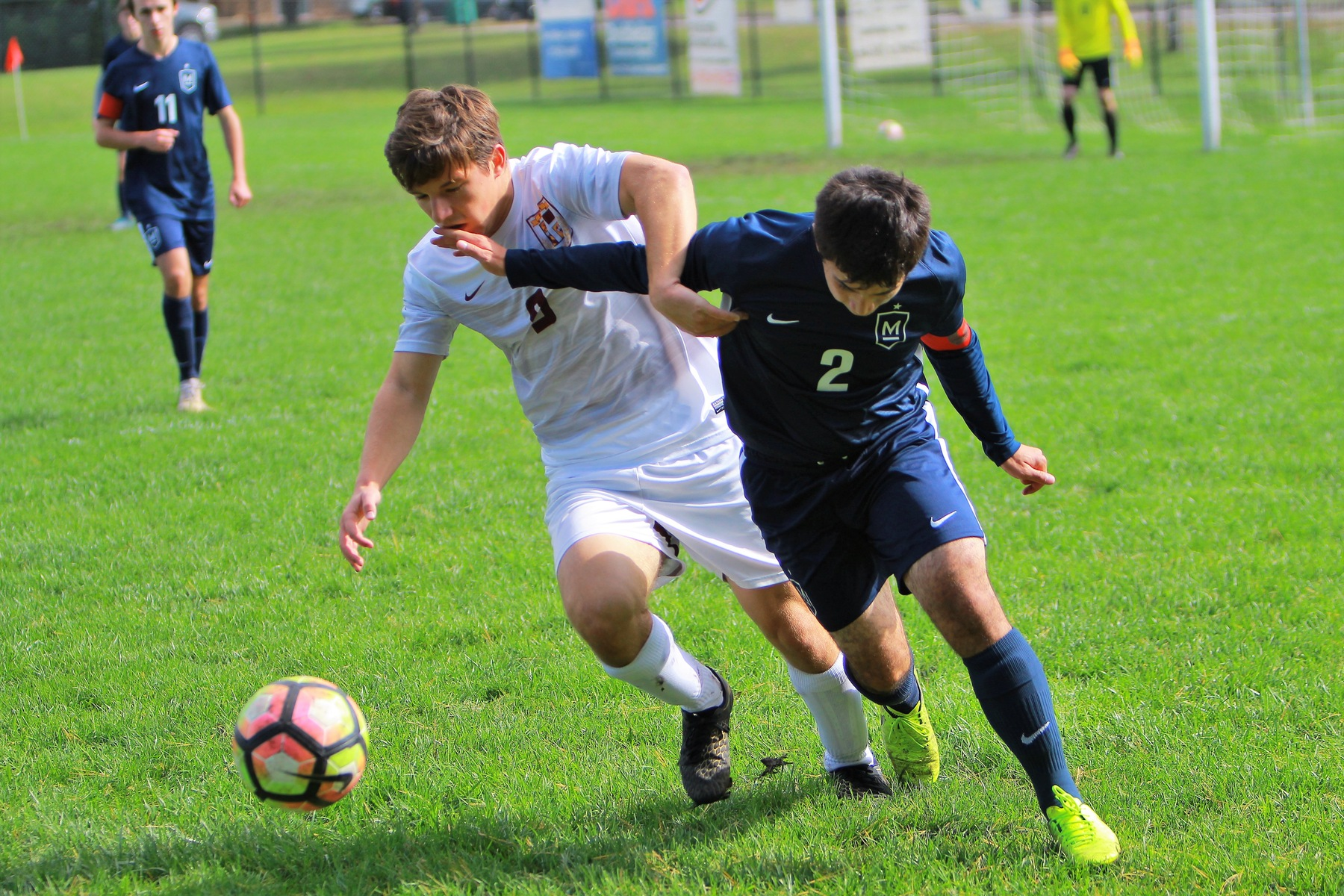 Faith Eagles defender Noah Zollinger battles a Maranatha player for the ball. The Eagles fell to the Sabercats, 3-0, to end the season.