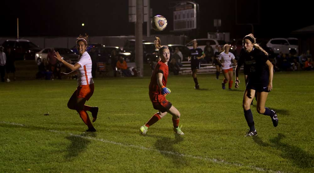 Jen De Leon De Leon watches Kat Stroot's winning goal pass by Sarah Cradick in double overtime on Saturday night.