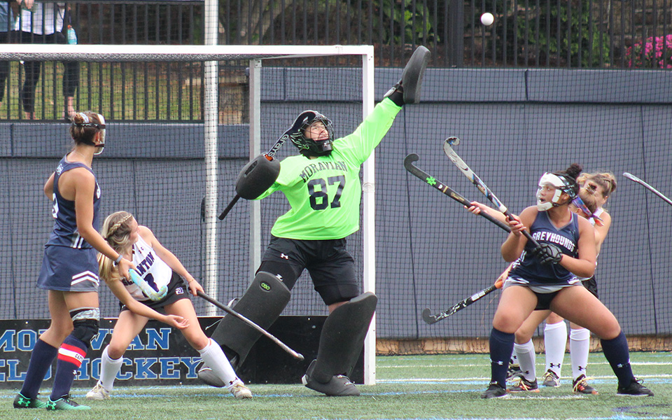 Junior goalie Ashley Kunsman makes a save on a penalty corner during the first half versus The University of Scranton on John Makuvek Field.
