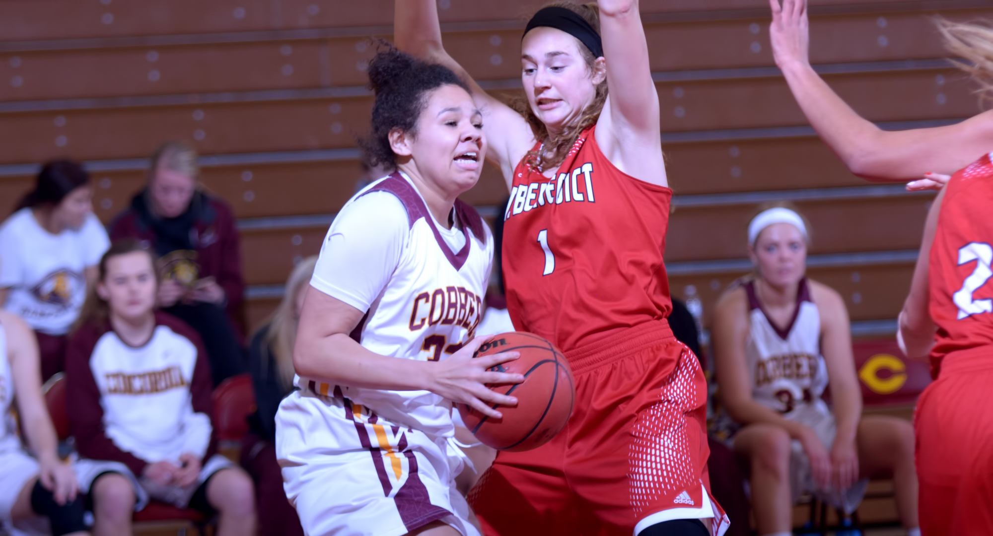 Sophomore Aleya Parker tries to get past a St. Benedict defender during the Cobbers' first game of 2018. Parker finished with seven points.