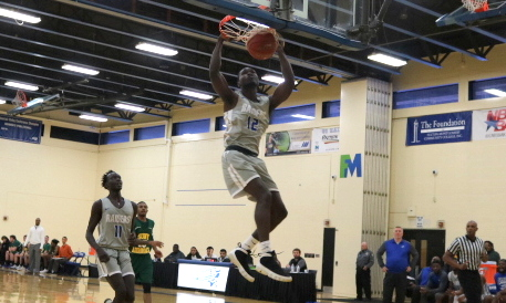 Jaleel Jean Jacques converts on a dunk against Adirondack.