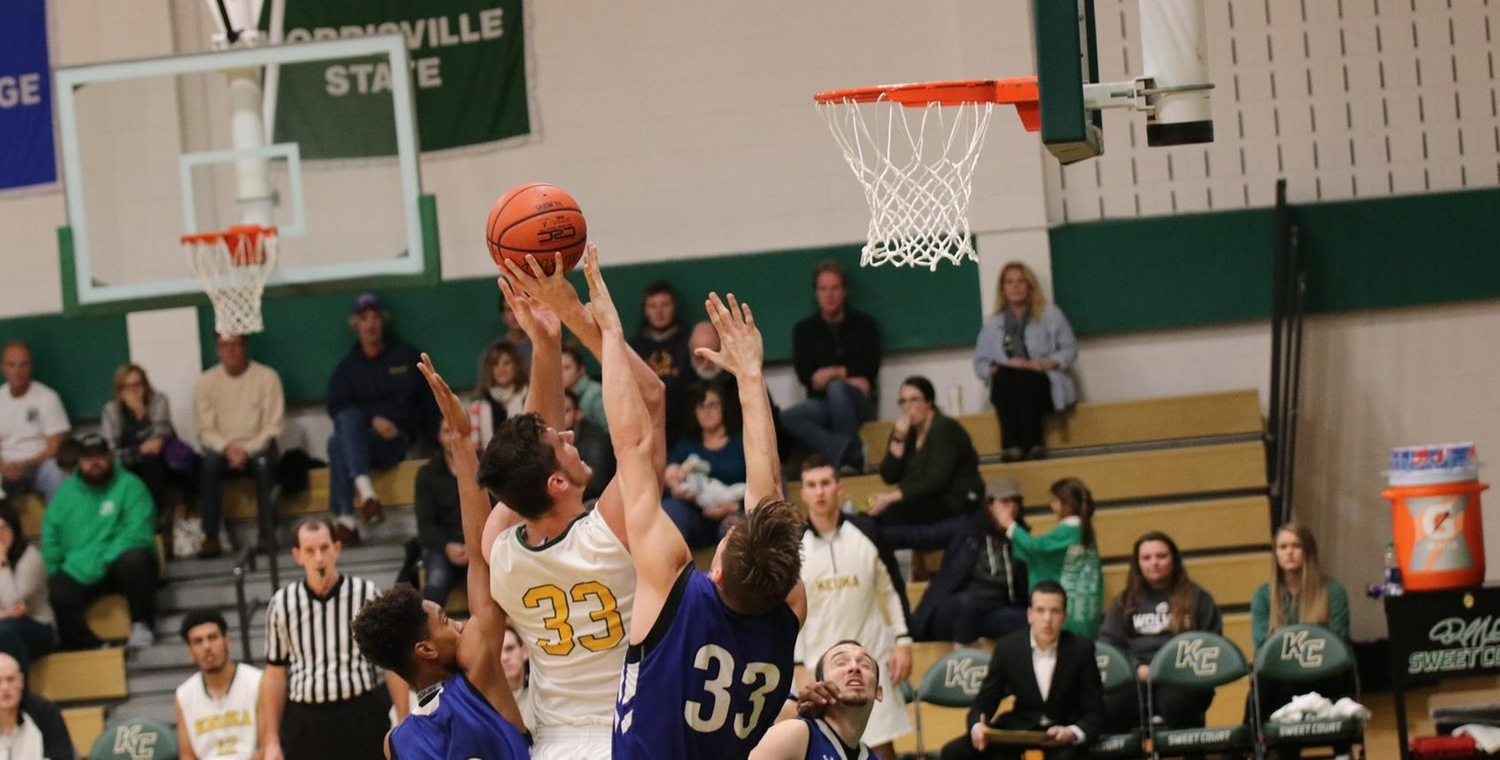 Ryder Mansfield (33) led the Wolves with 30 points and 16 rebounds -- Photo by Rohel Duncan