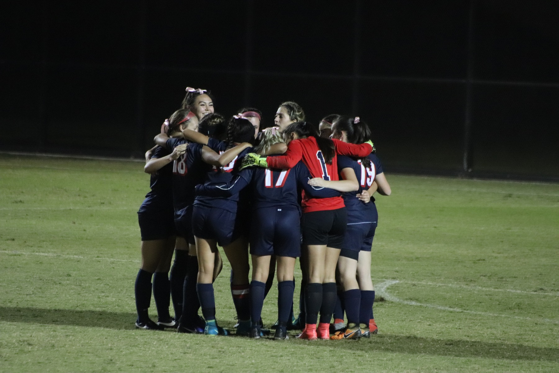 Women's Soccer team in a huddle