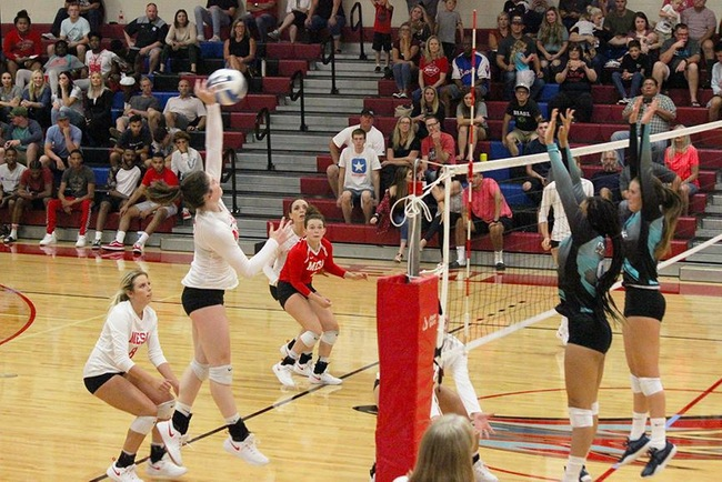 Mesa's Becca Belles goes high for the kill Wednesday night against the Chandler-Gilbert Coyotes.  (Photo by Aaron Webster)